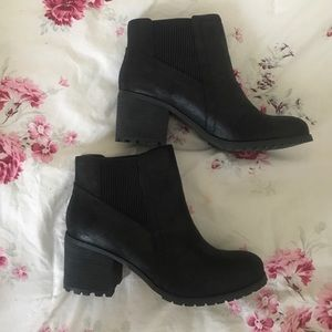 Restricted black ankle boots